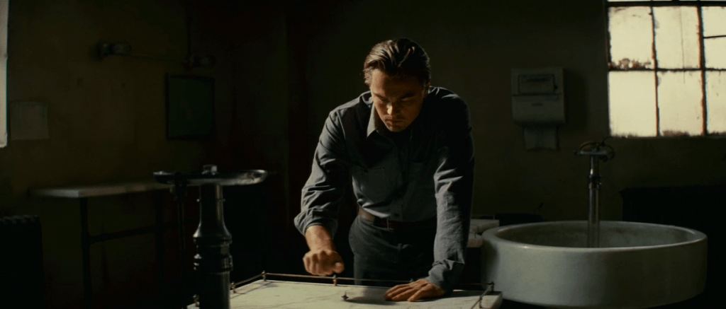 inception_movie_hd_trailer_stills_nolan_dicaprio_ellenpage11-1024x437